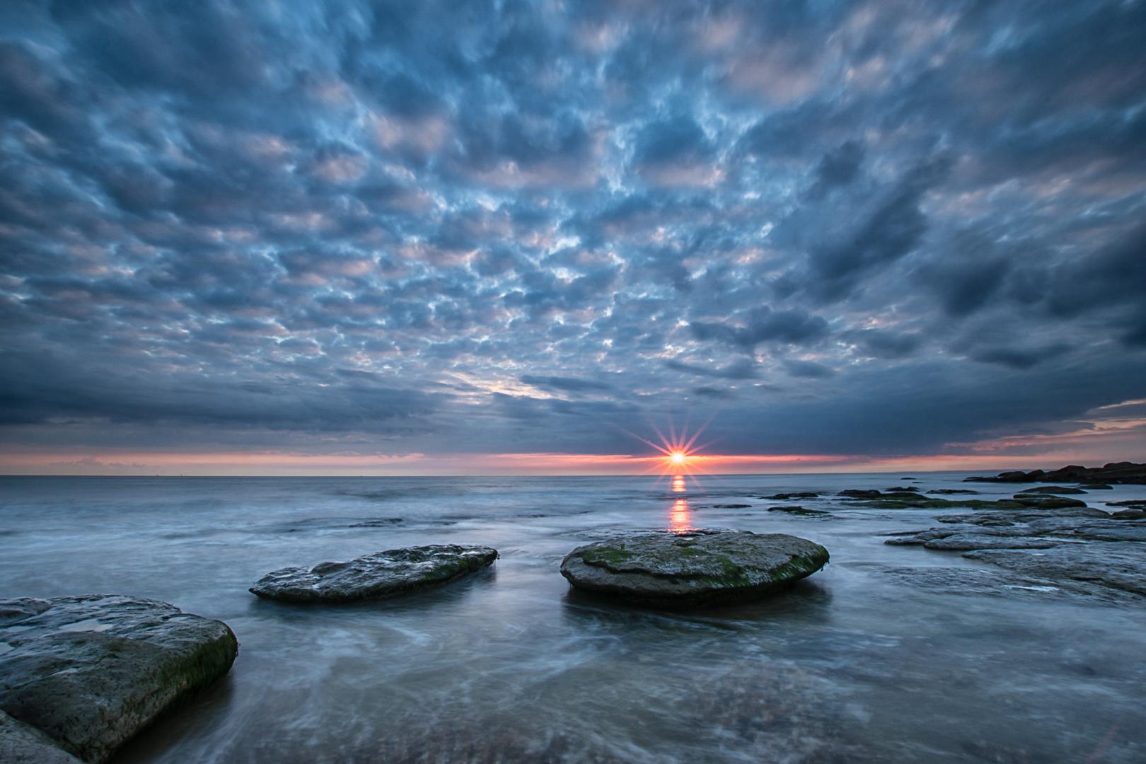 Zonsondergang Opaalkust